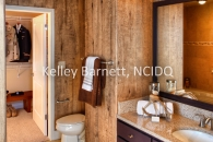 Hi rise condo bathroom, bathroom remodel, men's bathroom design, rustic bathroom design, brown painted cabinets, Shaker cabinets, faux wood wall, wood walls, wood wall bathroom, custom wall finish, iron and alabaster glass vanity light, alabaster vanity light, granite countertop, #interiordesign, #interiordesigner, #interiordecorating, #interiordecor