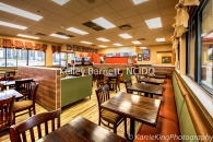 Frontier Burger restaurant, Frontier Burger in San Antonio, custom stained wood posts, red bollards, Karrie King Photography, bronze windows, bronze commercial windows, red gutters, custom booth, vinyl booth, porcelain wood look tile, porcelain wood tile, Wilsonart wrapped pony walls, Wilsonart, plaid window coverings, plaid and burlap window coverings, antique restaurant signage, Armstrong ceiling panels, solid surface window sills, commercial roller shades, red tile walls, #interiordesign, #interiordesigner, #interiordecorating, #interiordecor