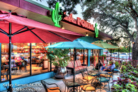 Restaurant design, restaurant exterior design, restaurant interior design, Sherwin Williams paint, turquoise stucco, speakeasy wood doors, calves, red fence, La Fonda restaurant, La Fonda in San Antonio, Victorian lighting, Mike Farquhar Photography, striped patio cushions, #interiordesign, #interiordesigner, #interiordecorating, #interiordecor